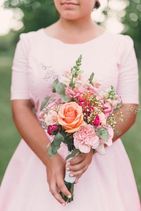 light pink bridesmaid dress with matching bouquet #bouquet #bridesmaid #weddingchicks http://www.weddingchicks.com/2014/01/24/pinterest-inspired-vintage-wedding/