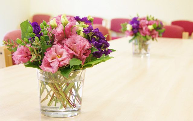 Colourful boardroom floral table centres for a corporate event. Florissimo, Shropshire