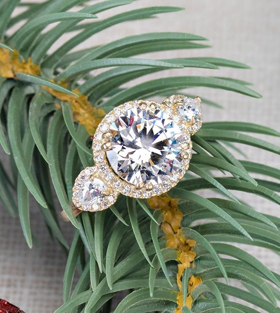 We're going to let it glow in this ring all season long! With over 6 carats of sparkle set in luxurious yellow god, this ring is guaranteed to make you the center of attention. Get ready to mix and match it with all of your holiday party attire and wow the crowd! [Promotional Pin]