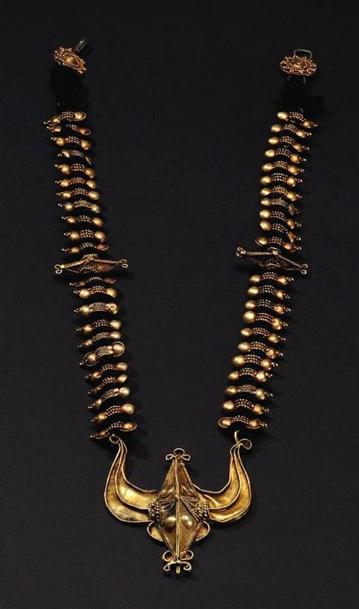 Indonesia ~ Sumatra | Batak Karo necklace with buffalo head; gold and black…