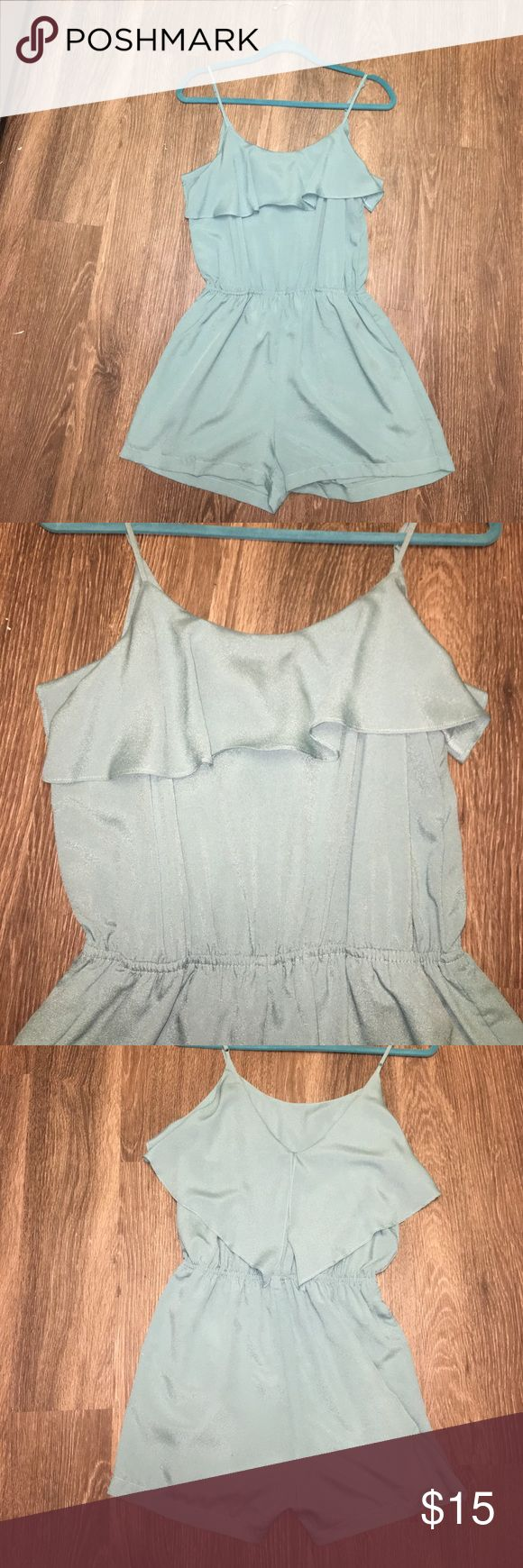 Light blue ruffle romper! this light blue ruffle romper is perfect for spring or summer! Only worn once!! Size medium Naked Zebra Pants Jumpsuits & Rompers