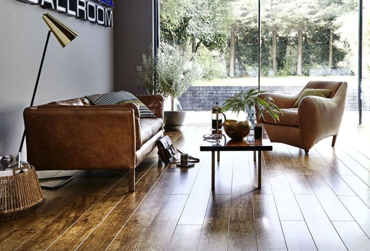 Wood or carpet for your living room? Follow these flooring tips