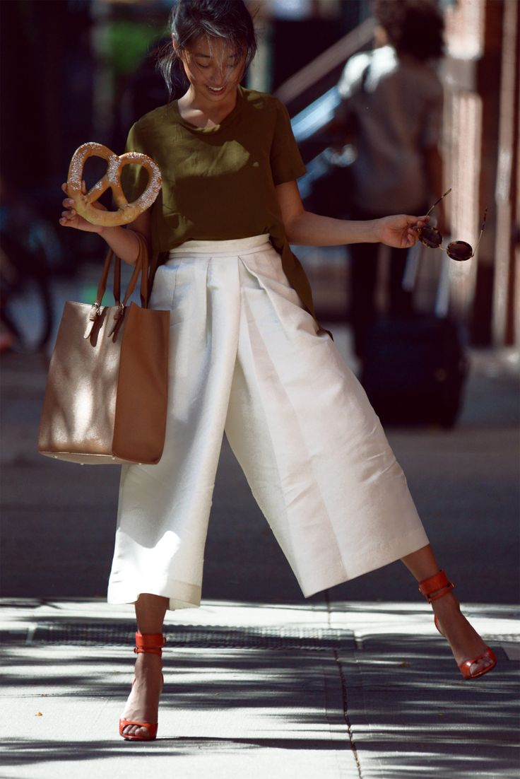 Margaret Zhang wearing white gaucho pants