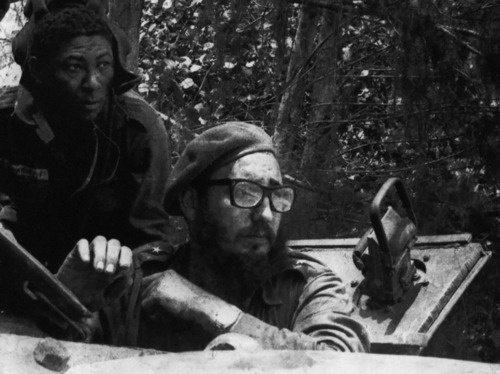 """""""Fidel Castro sits in a tank during the Bay of Pigs Invasion in April of 1961."""""""
