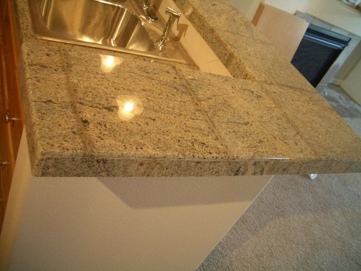 Best 25 granite tile countertops ideas on pinterest for Tile bar top ideas