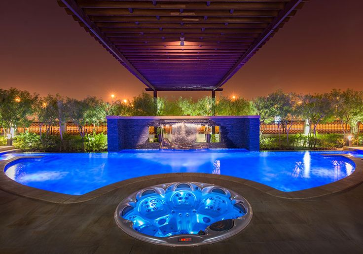 With Colorful Pool Landscape Lighting And Two Sheer Descent Waterfalls This Pool And Inground