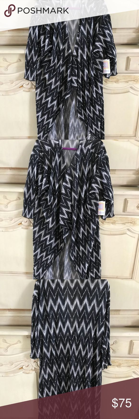 Shirley ! Gorgeous chevron ! Soft and elegant ! Great for a New Year's Eve dinner or party or on a cruise for formal night! Very flattering Tops Tunics