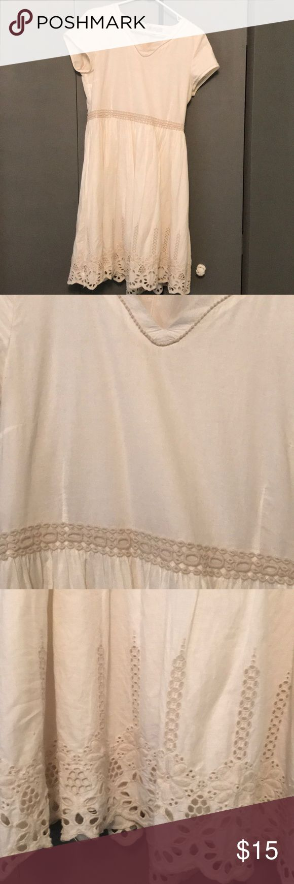 Cream mid-length dress w/embroidery detail size M Cute and comfortable cream dress with embroidered detail on collar, waist, and bottom of dress. Hits just below the knee and has cap-sleeves. Worn for a wedding and a few times afterwards. Just a little wrinkly, but in great condition besides that! Message for details! Downeast Dresses Midi