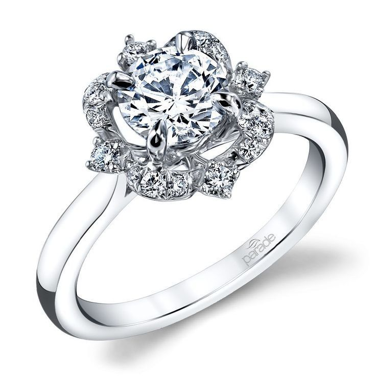 Parade Design's Hemera Bridal collection's R3672 features a delicate white gold base adorned by a unique vintage style halo. Sixteen round diamonds are surrounded by milgrain for approximately 1/6 total diamond weight.
