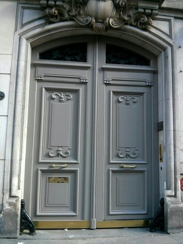 Gray classic parisian wooden double door in french - Traditional french doors exterior ...