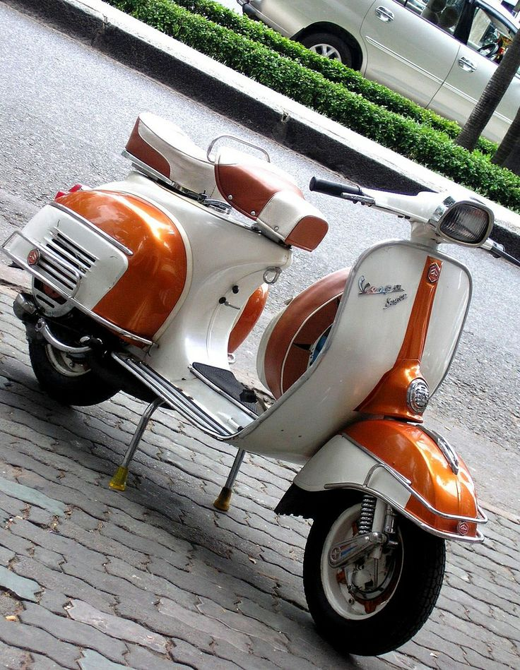 Vespa sprint had the same one in white with red lovely scooter