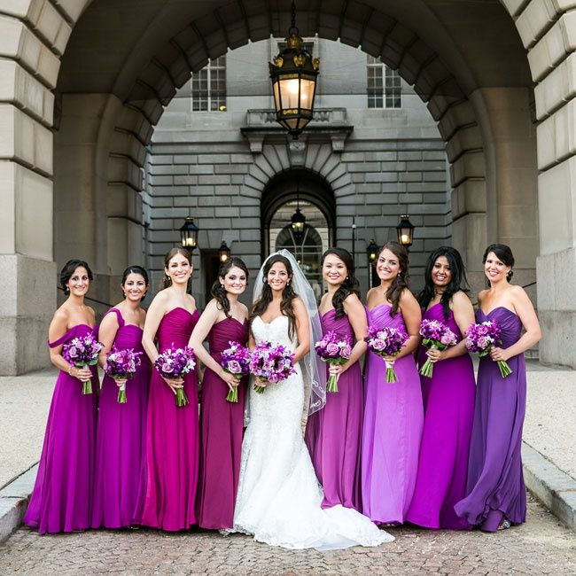 The bridesmaids wore floor-length, strapless chiffon dresses with sweetheart necklines. The colors of the gowns created an ombre effect, from dark purple to lavender and lilac to fuchsia.