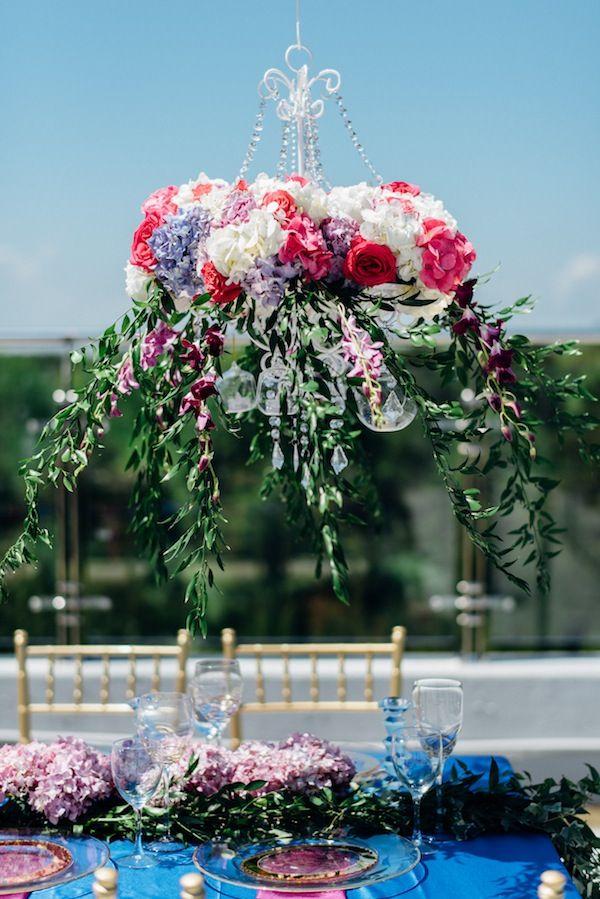 Garden Wedding Centerpiece | Rosie Omar Photography on @AislePerfect via @aislesociety