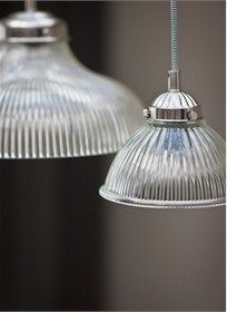 Our Petit Paris Light, with shaped glass shades and nickel coated steel fixings, hangs elegantly within any living space.