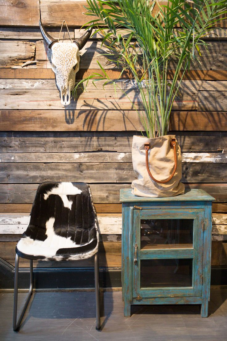 Cowhide chair perfect to accentuate wood pieces in a living room.