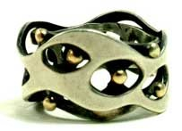 "Art Smith. 'Trapped Balls' ring c. 1960. silver, gold. One of the leading modernist jewelers of the mid-twentieth century, Smith trained at Cooper Union. Inspired by surrealism, biomorphicism, and primitivism, Art Smith's jewelry is dynamic in its size and form. Although sometimes massive in scale, his jewelry remains lightweight and wearable. See ""From the Village to Vogue: The Modernist Jewelry of Art Smith""."
