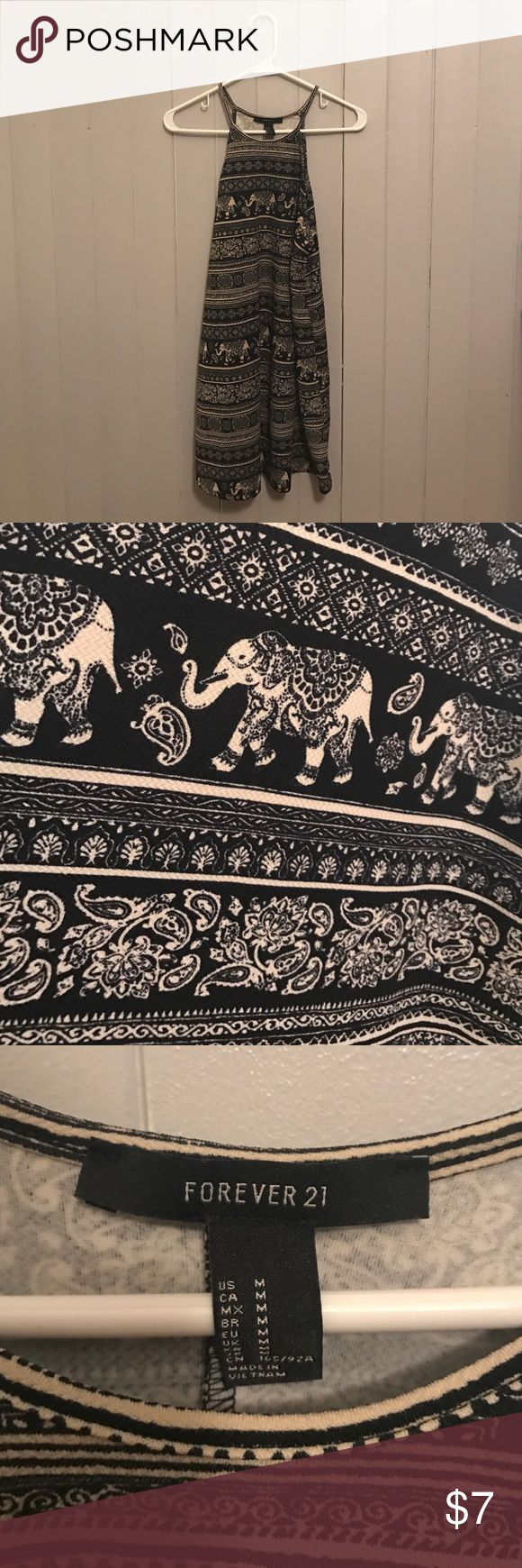 """Forever 21 black elephant tribal print dress Black and cream/tan elephant tribal print dress from Forever 21. I'm 5'4"""" and it falls a little above the knees. This was worn 1-2 times and in like new condition. Forever 21 Dresses Midi"""