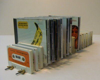 Cassette Tape CD rack...this is a nifty way to recycle cassette tapes....
