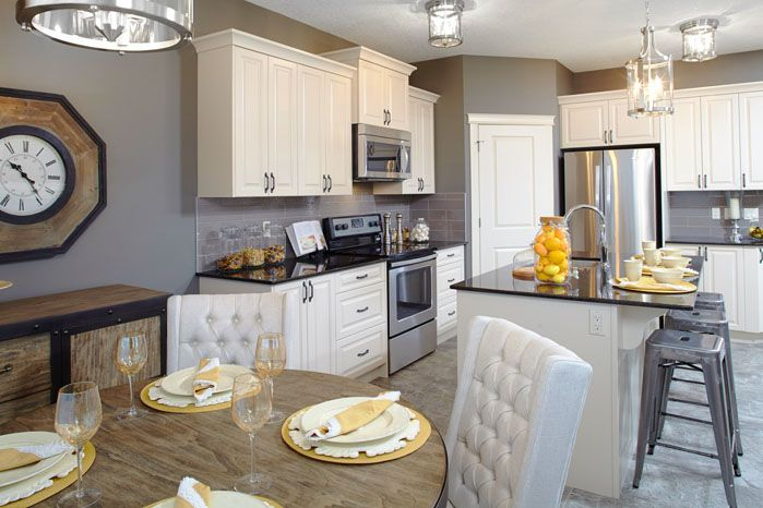 Dining room and kitchen in the Orion II showhome in King's Heights in Airdrie, by Shane Homes.