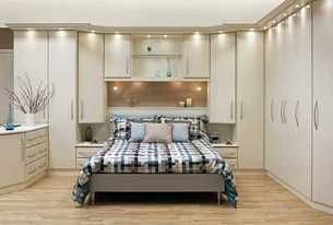 Built in wardrobe, closet, or storage around the bed. Small bedroom - light and white. This is kind of dated-looking, but like the idea of added storage.