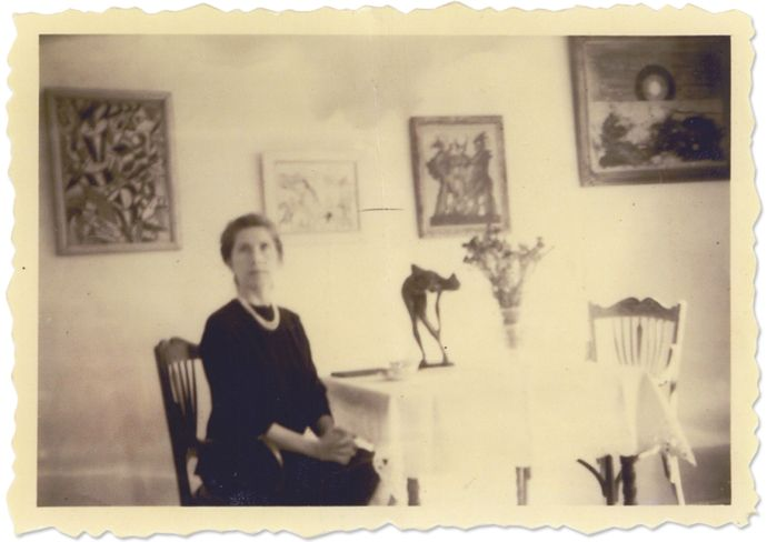 Helene Beltracchi, posing as her grandmother, in a pseudo-antique photo staged to lend credibility to the fictional provenances of Wolfgang Beltracchi's forgeries. Hanging on the wall at left is a fake Fernand Léger; at far right is a phony Max Ernst., From Polizei/dapd/ddp images/AP.
