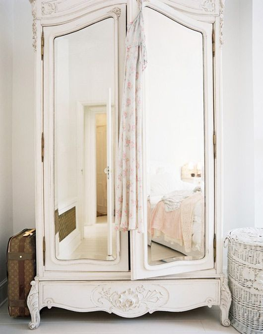 White wardrobe with mirrors. Mirrors in general cause a room to feel larger and more bright and having one next to your clothing is convenient!