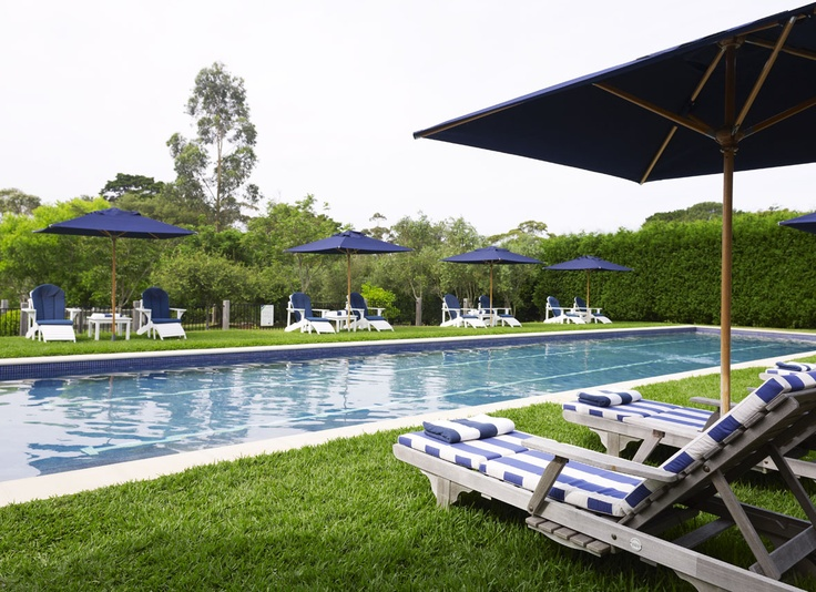 Sunlounges & umbrellas by the pool