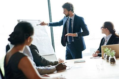 Shot of a group of executives having a meeting in a boardroom - stock photo #1325550
