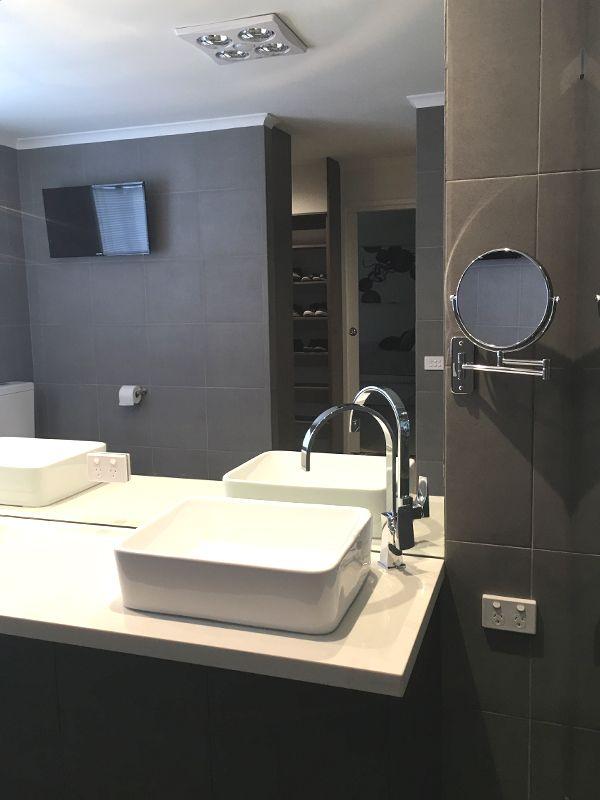 Ensuite bathroom design including walk-in-robe by Emme Designs.