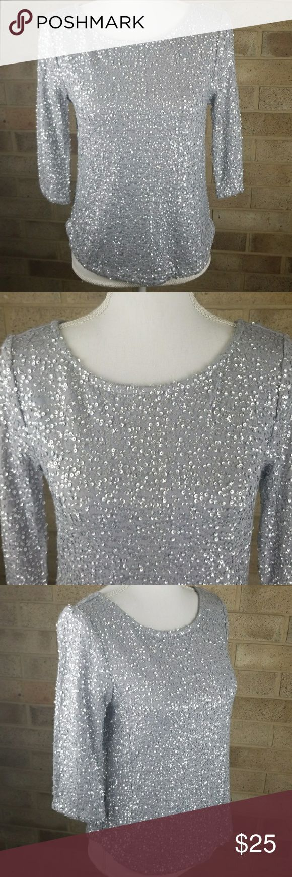 JOE FRESH Silver Grey Sequin Blouse Small I have here this super cute grey and silver quarter sleeve blouse. This blouse is from Joe Fresh and that is a size Small. There are no signs of wear, no stains or rips!  I LOVE OFFERS SEND ONE! BUNDLE TO SAVE! SORRY NO TRADES! Joe Fresh Tops Tees - Long Sleeve