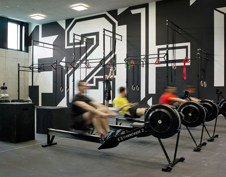 andreas uebele and his team kitted out a new adidas gym in germany with super-sized words and numbers that contain hidden meaning.