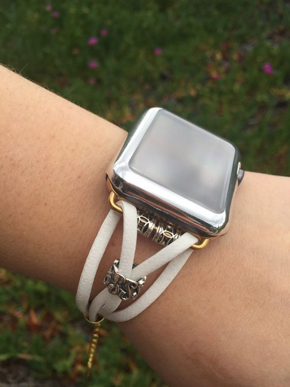 White leather strappy Apple Watch Bracelet with silver findings (silver adapters, beads and lobster claw class) or white leather with gold findings (gold adapters, beads and lobster claw clasp). Pictured on a Space Gray Sport Watch with the Silver Tone Co