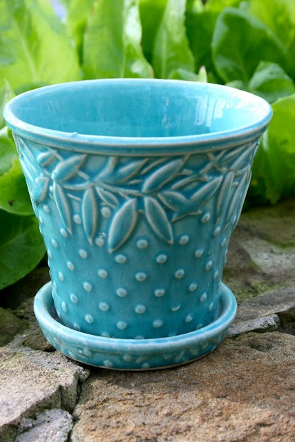 McCoy flower pots.  I have several in different colors.  Love them with or without flowers.  You can use them in the house or outside for many things.