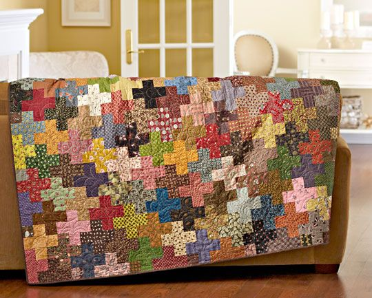 "No two plus signs in this throw are the same! Dig into your stash--or swap 2-1⁄2""-wide strips with your friends--to create a quilt that's positively ""scraptacular."""