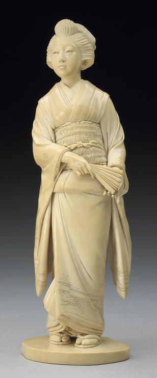 A good ivory okimono of a beauty Meiji Period, Signed Kodo