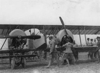 """ROMANIAN FIRST WORLD WAR OFFICIAL COLLECTION"" (photographs) Made by: Romanian official photographer 1917  Q 76398  Romanian airmen working an a twin-engined aircraft in Onesti, 1917."