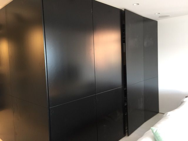 Tall hidden cabinet on Black Poly finish with internal soft close drawers and adjustable shelves