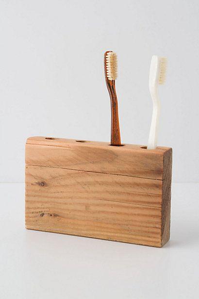 Wooden toothbrush holder.