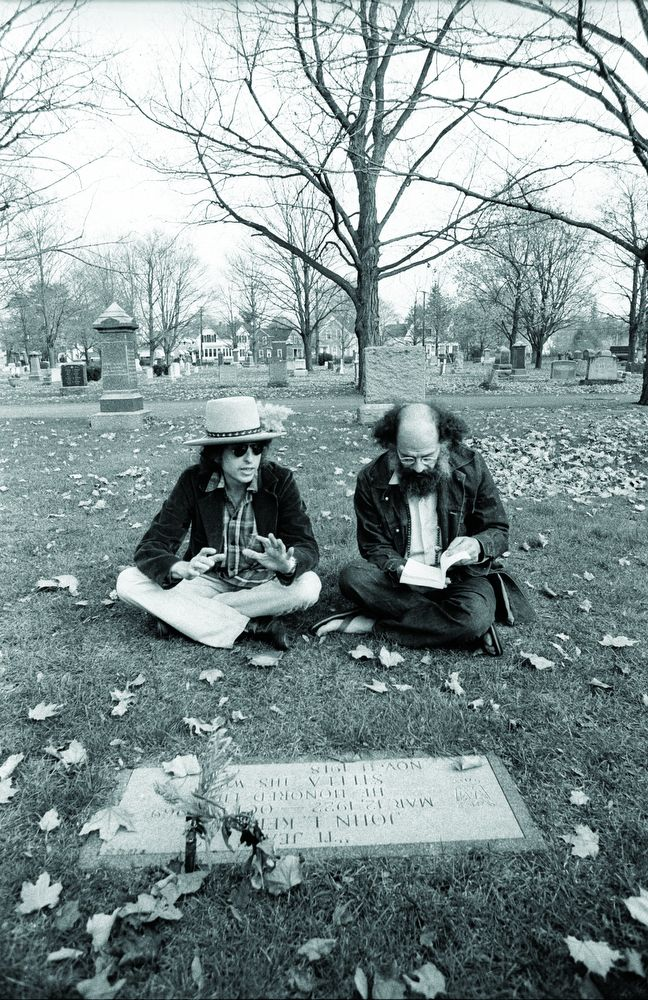 Dylan and beat poet Allen Ginsberg sitting at Jack Kerouac's grave during the Rolling Thunder tour.