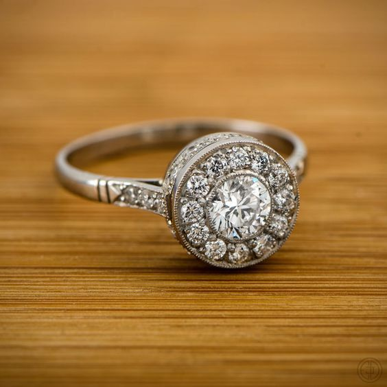 Vintage style diamond engagement ring set with a lively diamond in the center by Estate Diamond Jewelry.