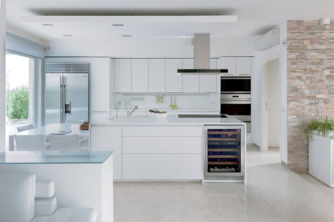 The sleek, modern design of Sub-Zero and Wolf products work seamlessly with this all-white kitchen.  Courtesy of Sub-Zero Group, Inc..