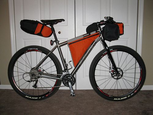Full DIY Bikepacking Kit // The seat pack is a 'holster' which holds a dry bag. There is a strap around the end that compresses the load lengthwise. The seat attachment also helps compress the load. It pulls up tight and rides well.