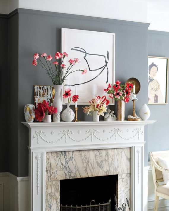 Eschew the expected fireplace garland. Instead, group different styles and sizes of vases, and fill them with long and short stems of red amaryllis, red-and-white carnations, anemones, and striped amaryllis. Coordinate the colors of the vessels (in this case, gold and white) for a cohesive look.Painting (untitled), by Nick Barbieri, $1,800, cristina dossantos.com. Bavarian porcelain vases, with gold-leaf coral motif, Rorschach motif, and gilt bird design, from $295 to $375 each, theend...
