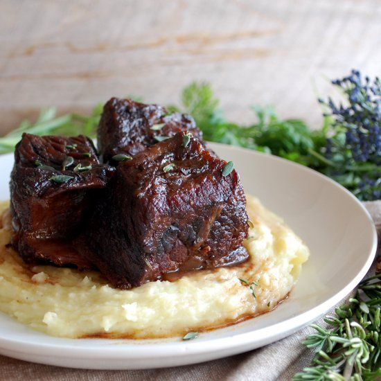 Melt-in-your-mouth braised short ribs in an earthy red wine sauce. Served over caramelized horseradish potato puree.