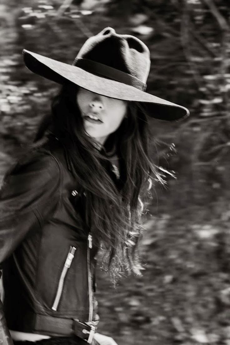 I would never wear that hat, but I do like the way her entire self is put together. cool pic!