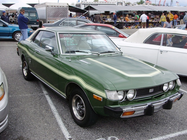 My first car was a green 1975 Toyota Celica GT like this without the stripes