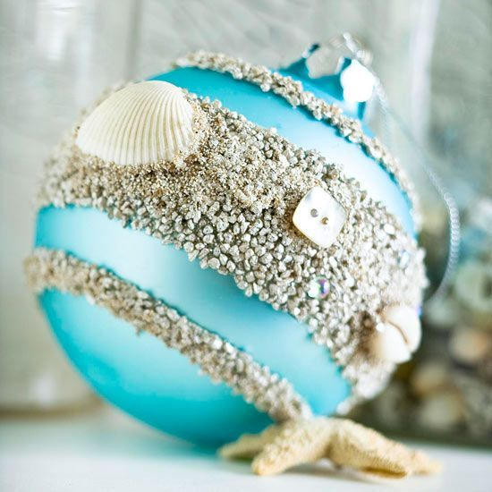 Oceanside Ornament. Tape off stripes around the ornament. Coat the bare areas with crafts glue and sprinkle with coarse sand; let dry. Finish by gluing on small shells or mother-of-pearl buttons.