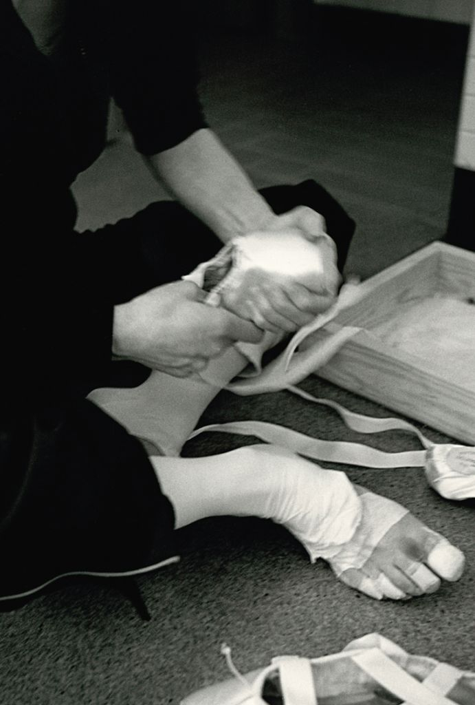 "darcey bussell book  ""Protecting my feet for the performance ahead. I individually bandaged each toe so that I didn't get too many blisters. I have always felt this must be similar to strapping a boxer's hands."" Photograph : Bryan Adams"