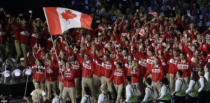 A streak of red as Canada make their way into the stadium. The flag bearer was Simon Whitfield, a triathlete who won gold in the 2000 Sydney Games
