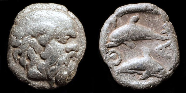 silver tritartemorion struck in Thasos circa 411-404 BC. Satyr on the obverse and dolphins on the reverse